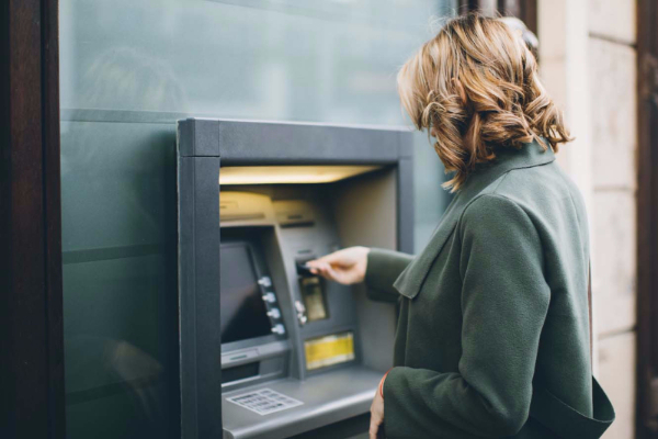 A woman getting money from an ATM.